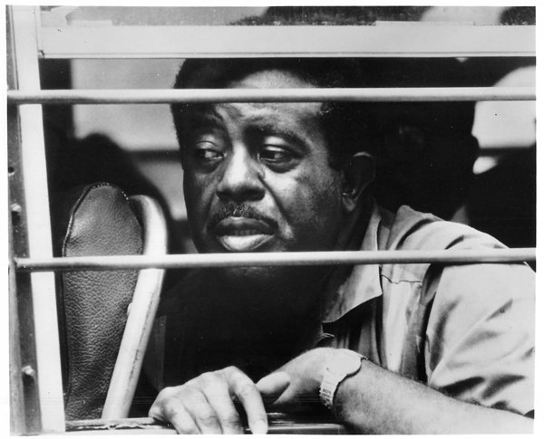 (1968) The Rev. Ralph Abernathy peers through the barred window of a bus taking him to jail in Washington, D.C. The head of the Southern Christian Leadership Conference, with some 300 others, was arrested for attempting to demonstrate on the Capitol grounds. His arrest followed ousting of residents from Resurrection City by police. Religion News Service file photo