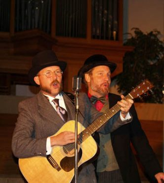 Tony Jones, left, and Mark Scandrette portray traveling evangelists circa 1908 in the Church Basement Roadshow, a light-hearted tour performed by leaders of Emergent Village. Religion News Service photo courtesy Doug Pagitt