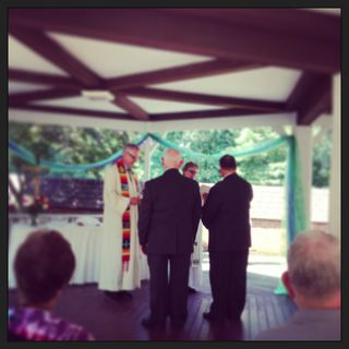 The Rev. Kathryn Johnson performs a wedding ceremony between David Shumate and Andy Ragland.