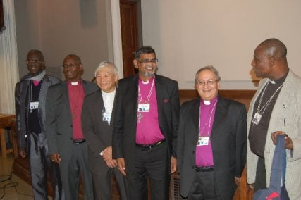 Among others, (center) Archbishop Ian Ernest, of the Province of the Indian Ocean, with (second from right) Archbishop Mouneer Anis, of Egypt, and (far right) Bishop Josiah Iduwo-Fearon of Nigeria, at the conclusion of the Anglican Back to the Future Conference in Toronto, Canada, on Wednesday (Sept. 18). RNS photo by Bob Bettson