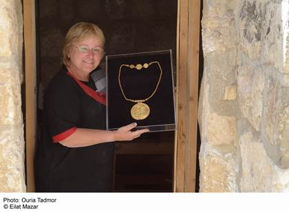 A cache of gold coins, jewelry and what is believed to be a Torah scroll decoration were discovered at the foot of the Temple Mount. Photo courtesy the Hebrew University