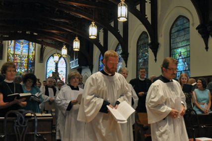 Jeremiah Griffin (left) and Mark Marmon (right) in procession during Ordination on June 15. They are two of 13 people ordained to the diaconate at Christ Church Cathedral. Photo by Carol Barnwell, Episcopal Diocese of Texas.