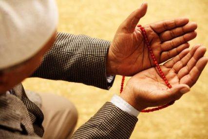 Hands with muslim prayer beads