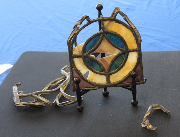 A stained glass rosette and twisted metal from the 1963 bombing of the Sixteenth Street Baptist Church in Birmingham, Ala. The memento was donated to the Smithsonian's National Museum of African American History and Culture by the family of a white Baptist minister on September 9, 2013. RNS photo by Adelle M. Banks