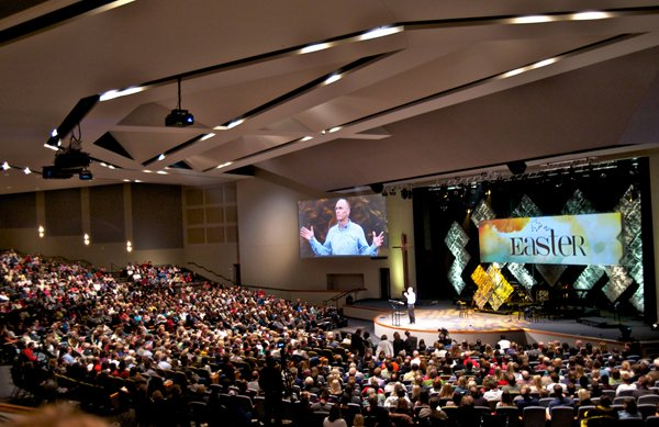 Each weekend, 18,000 people gather at one of Eagle Brook Church's five locations outside St. Paul, Minn., to hear pastors preach family-friendly sermons on avoiding excuses and learning to forgive. Senior Pastor Bob Merritt at the Lino Lakes campus is pictured here. Photo courtesy Eagle Brook Church