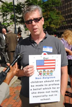 Andrew Hall, an atheist and father, demonstrates Wednesday outside the Massachusetts Supreme Judicial Court. He says recitation of the pledge of allegiance in schools should be deemed unconstitutional in Massachusetts. Photo by G. Jeffrey MacDonald