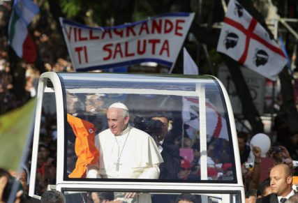 A shirt is thrown into the popemobile as Pope Francis arrives for an encounter with youth in Cagliari, Sardinia, Sept. 22. Photo by Paul Haring/courtesy Catholic News Service