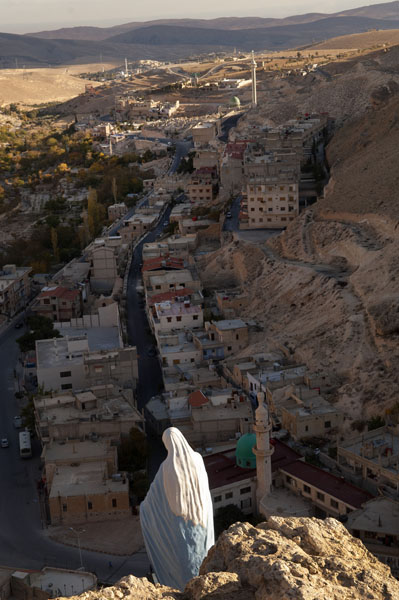 View of Maalula village with Christian statue of the Virgin Mary and Muslim Mosque. Photograph By John Wreford/courtesy Associated Reporters Abroad