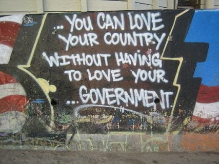 """You can love your country without having to love your government"", libertarian/anarchist/activist graffito in Bolinas, California."