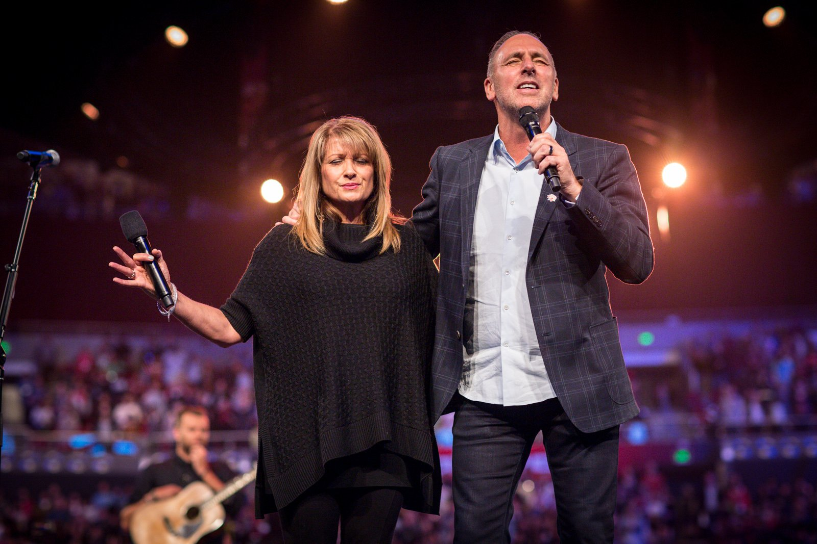 Senior Pastors Brian and Bobbie Houston in prayer at Hillsong Church. Photo courtesy Hillsong Church