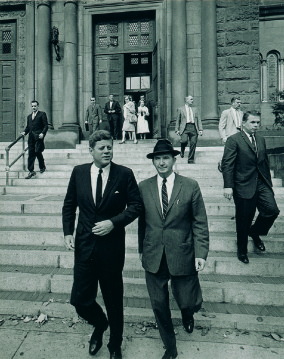 President Kennedy leaving the Cathedral of St. Matthew the Apostle in Washington, DC, with his friend and assistant, David Powers, on May 31, 1962. Kennedy gave Powers the Rosary that will be auctioned this month
