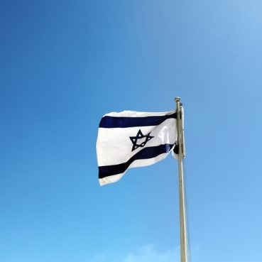 Israel flag against a blue sky
