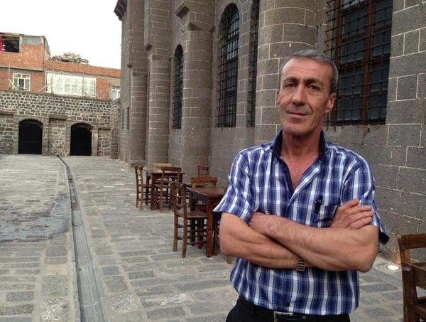 Arahim Demirciyen stands outside the reconsecrated St. Giorgos church in Diyarbakair, Turkey. Photo by Gil Shefler