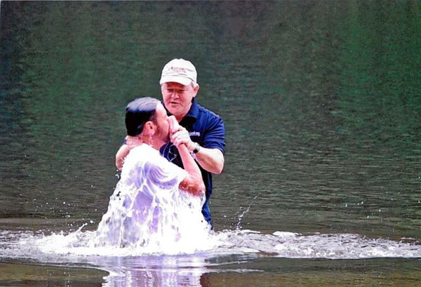 Dr. Frank Page baptizes Stephen Allmond in 2008 at Paris Mountain State Park near Greenville, S.C. Photo courtesy Dr. Frank Page