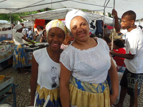 (Left) Juliana Lima and Jenifer Felicio pose for a photograph. Candomble youngsters grow up in the faith but ofter suffer discrimination because of their beliefs. Photo by Robson Coelho