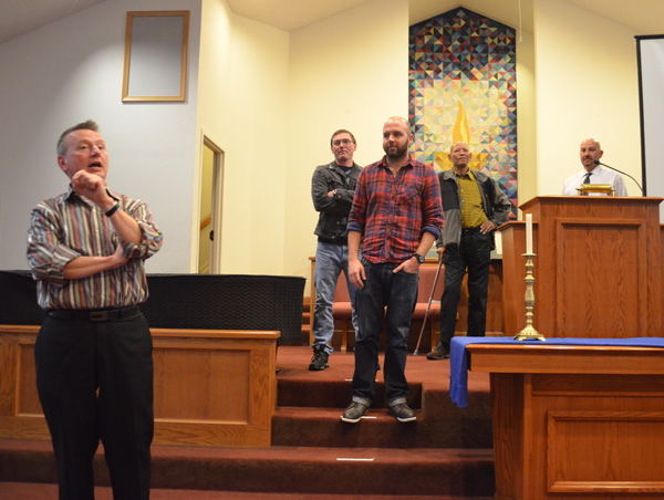 (Left to right) The Rev. Neil Kookoothe, Damon Thibodeaux, Will Francome, Delbert Tibbs and Joe D'Ambrosio field audience questions at First Unitarian Church in Toledo, Ohio. Photo by David Yonke/Toledo Faith & Values