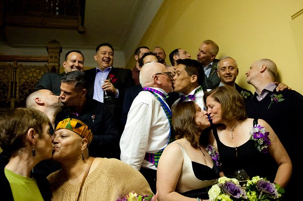 Couples kiss after they participated in the first same-sex marriage ceremony in Jersey City officiated by Mayor Steve Fulop at 12:01 a.m. Monday, Oct. 21, 2013, at City Hall. Photo by Reena Rose Sibayan/The Jersey Journal - courtesy The Star-Ledger