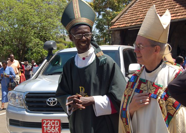 Archbishop Justin Welby of Canterbury and GAFCON Chairman Archbishop Wabukala of Kenya walk together at All Saints Cathedral in Nairobi in 2013. Welby visited Kenya before the GAFCON II meeting in Nairobi. RNS photo by Fredrick Nzwili