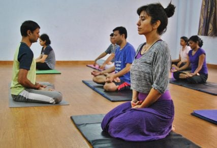 Private yoga instructor Shailendra Singh (far right) leads a group of young professionals at The Yoga Guru club in Noida in Delhi's suburbs on Oct. 25, 2013. Photo by Vishal Arora