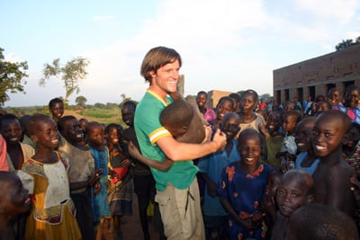 Jason Russell meets with Ugandan children in the film ``Invisible Children,'' which focuses on the plight of exploited children in the war-torn nation. Religion News Service photo courtesy of Invisible Children