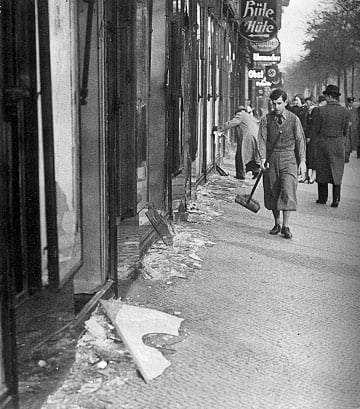A boy cleans the street after Kristallnacht in November 1938. Religion News service file photo