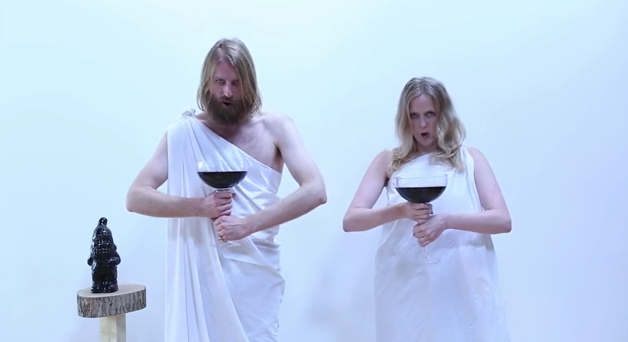 Sunday Assembly founders Sanderson Jones and Pippa Evans, in a promotional video, mocking themselves as a cult that's not really a cult.