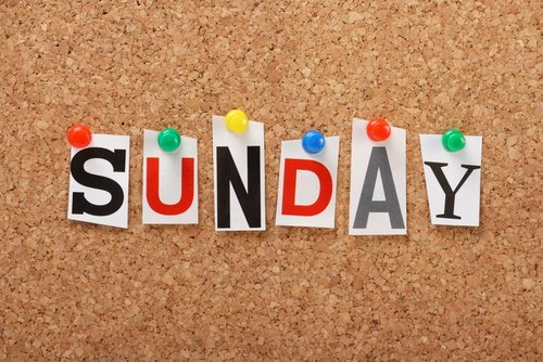 The word Sunday in cut out magazine letters on a cork board.
