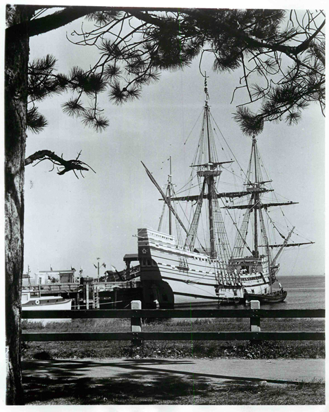 (1963) Close the mind's eye to sidewalk, fence and modern dock and the scene viewed is that of the Mayflower, anchored off Provincetown, Mass. in Nov. 1620. Pilgrims, who sailed from Plymouth, England, on Sept. 6 of that year, can be visualized descending from the ship into the shallop (open sailing-rowing boat) at the Mayflower's side to explore land suitable for settling. The Mayflower II, today anchored in Plymouth Harbor, recalls that early beginning of America. Religion News Service file photo