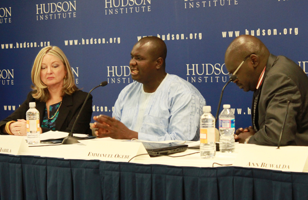 Nigerian Adamu Habila, center, describes a Boko Haram attack on his neighborhood while Nina Shea, left, director of the Center for Religious Freedom at the Hudson Institute, and Emmanuel Ogebe, international human rights lawyer, listen on during a panel on Thursday (Nov. 14). RNS photo by Katherine Burgess