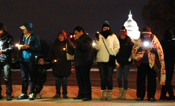 Immigration reform supporters pray and sing in both English and Spanish outside the U.S. Capitol on Tuesday night (Nov. 12, 2013), calling on Congress to pass comprehensive immigration reform. RNS photo by Katherine Burgess