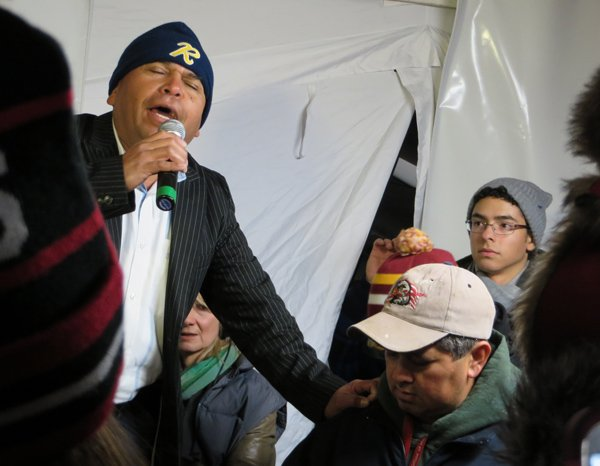 Ruben Quiroz sings a self-composed song for immigrants to the U.S. at the