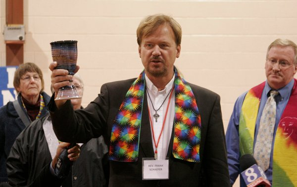 United Methodist Rev. Frank Schaefer serves communion to his supporters at the end of his two-day church trial. Photo by Kathy L. Gilbert/United Methodist News Service