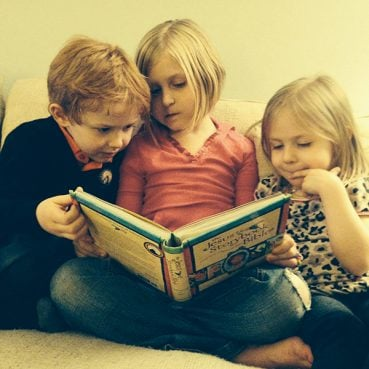 Left to right, Owen, 5, Corinne, 8, and Noelle Starke, 4 read from the Jesus Storybook Bible. Photo courtesy John Starke