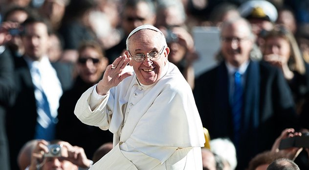 Pope Francis smiles and waves at his inaugural mass. (Photo courtesy of the Catholic Church, England and Wales - http://bit.ly/1dLE0m3)