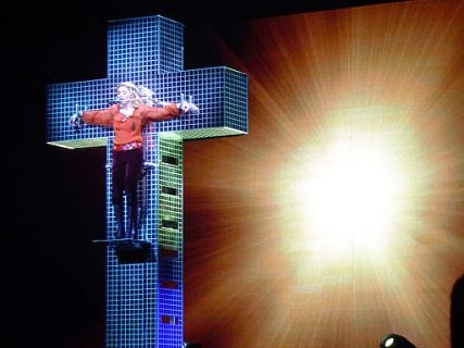 Madonna in her Confessions Tour, hanging from a mirrored cross in 2006.
