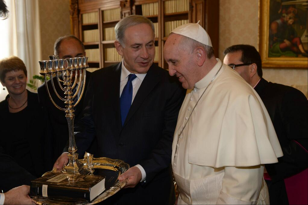 Israeli Prime Minister Benjamin Netanyahu exchanges gifts with Pope Francis at the Vatican Monday morning.