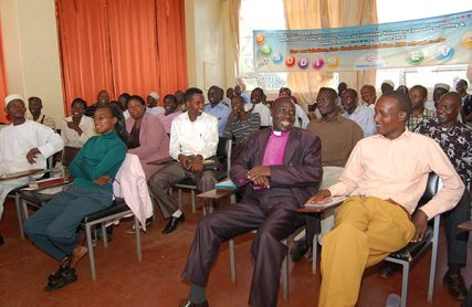 HIV+ Positive clergy for Christian and Muslim faiths who are members of the INERELA+ Kenya chapter share a light moment at one of their meetings. The clergy believe that HIV drugs are God's miracles to the people. RNS photo by Fredrick Nzwili