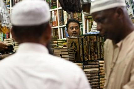 A man sells Qurans in Saudi Arabia.