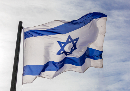 Israel flag in the wind isolated against the sky.
