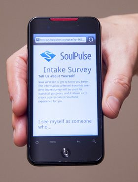 People can sign up at www.soulpulse.org for a two-week survey in which they'll receive two daily questionnaires via text or email or both. Photo courtesy of Sean Flynn/UConn Photo