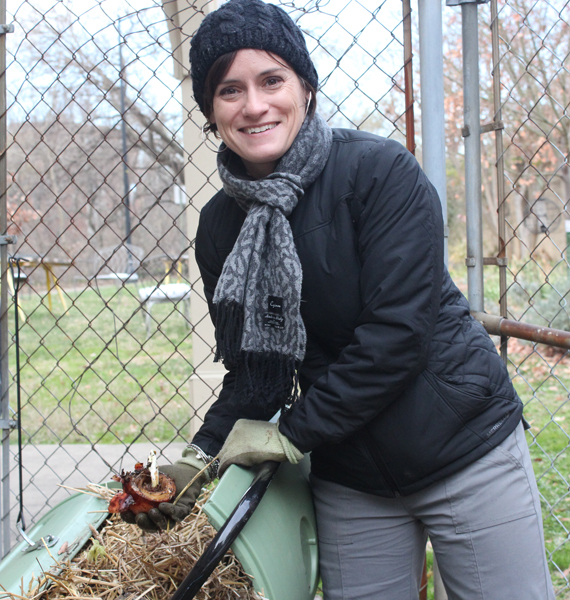Ashley Goff, minister for spiritual formation at Church of the Pilgrims, compares her time in her church's backyard to making lasagna -- spreading vegetable scraps in one layer, straw in the next. RNS photo by Adelle M. Banks