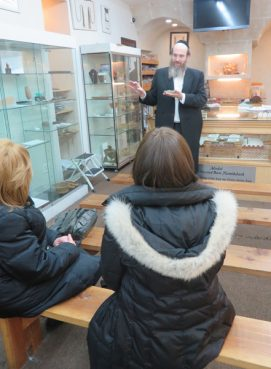 Rabbi Shaul Shimon Deutsch tells visitors about the biblical artifacts in his Living Torah Museum. RNS photo by David Gibson