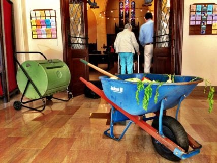 A wheelbarrow filled with compost at Church of the Pilgrims. Photo by Andrew Satter, courtesy of Ashley Goff