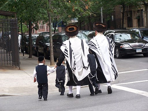 Ultra-orthodox Jews cross the street in Brooklyn.