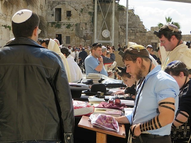 Men praying at the Western Wall