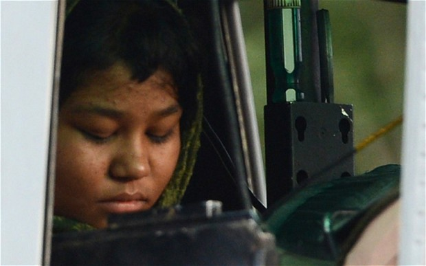 Rimsha in a police armored vehicle. Photo by Naveed Ahmad