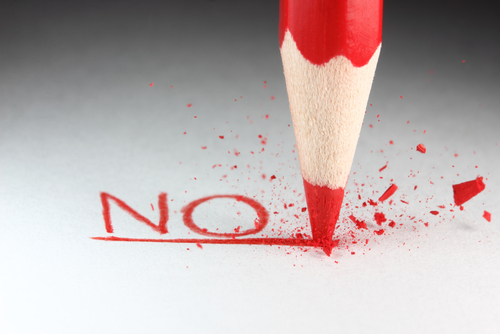 """A red pencil and the word """"NO."""""""