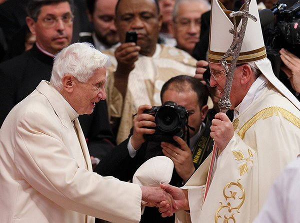 Retired Pope Benedict XVI greets Pope Francis at the conclusion of a consistory at which Pope Francis created 19 new cardinals in St. Peter's Basilica at the Vatican Feb. 22. Pope Benedict's presence at the ceremony marked the first time he had joined Pope Francis for a public liturgy. Photo by Paul Haring, courtesy of Catholic News Service