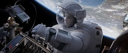 "Sandra Bullock, as a scientist lost in space, struggles with faith in ""Gravity."" Photo courtesy of Warner Bros. Pictures"