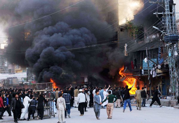 Participating in a procession mourning deaths of Prophet Mohammad's grandchildren, Shiites torch a market in Sunni-dominated Rawalpindi, a garrison city adjacent to Pakistan's capital Islamabad, on November 15, 2013. Photo by Naveed Ahmad